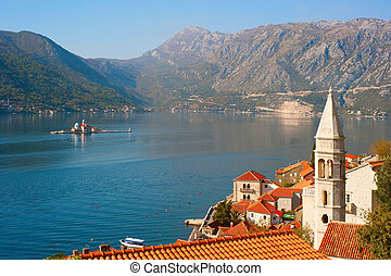 View of island of St. George and Our Lady of the Rocks and old architecture of Perast, Montenegro.