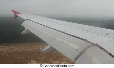 View of jet plane wing from illuminator - View from aircraft...