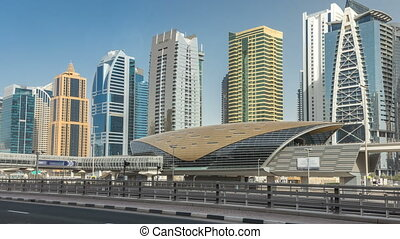 View of Jumeirah lakes towers skyscrapers and metro sration...