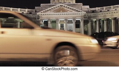 View of Kazan cathedral in Saint Petersburg in night. Many cars on road.