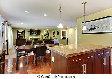 View of kitchen island and dining area - Kitchen island with...