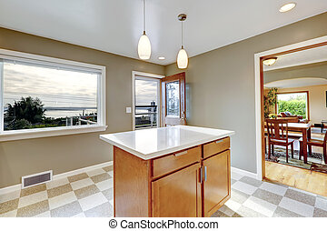 View of kitchen island and open door