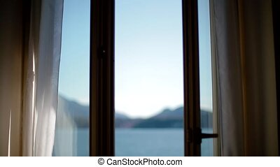 View of Lago Maggiore through closing window.