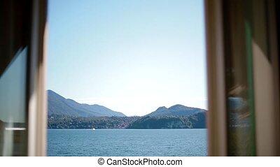 View of Lago Maggiore through open window