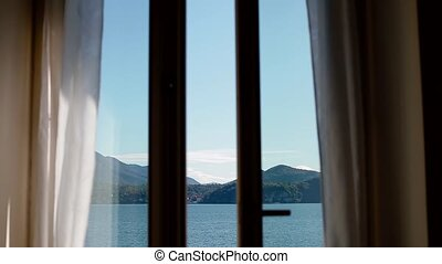 View of Lago Maggiore through opening window