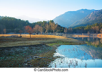 View of lake in autumn evening. Muga, Catalonia