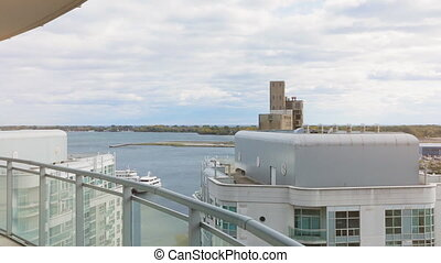View of lake Ontario from an condo balcony. Dolly shot