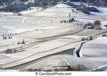 View of Langhe hills with snow and the village of La Morra Piedmont Italy