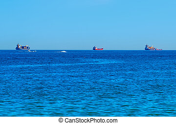 View of large commercial ships in the Mediterranean sea.