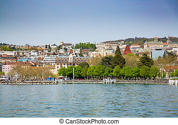 View of Lausanne city taken from ferry boat on Lake Geneva in Switzerland