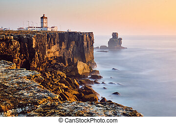 View Of Lighthouse And Sea In Peniche Portugal At Sunset
