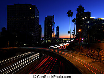 View of Los Angeles at dusk with cars on the freeway