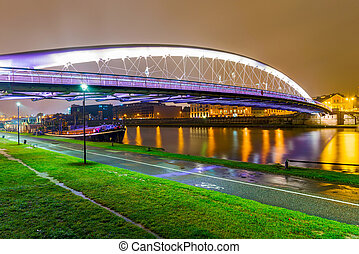 View of Lovers bridge from riverside park at night