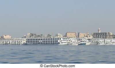 view of Luxor from boat sailing on Nile river