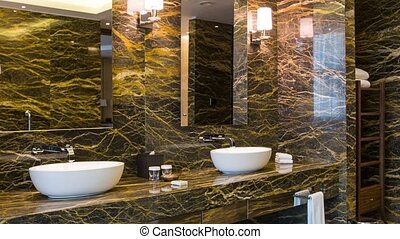 View of luxurious hotel bathroom - Live fully. Dolly shot of...