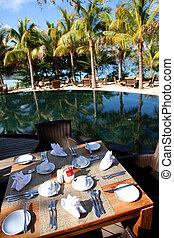 View of luxury resort restaurant tables