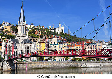 View of Lyon city and red footbridge on Saone river and ...
