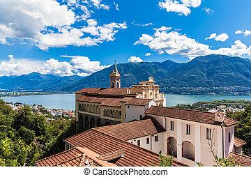 View of Madonna del Sasso Church above Locarno city and the Maggiore lake in Ticino, Switzerland