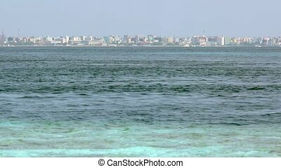 View of Male City from Vadhoo Island, Maldives