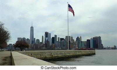 View of Manhattan, New York, USA. American flag.