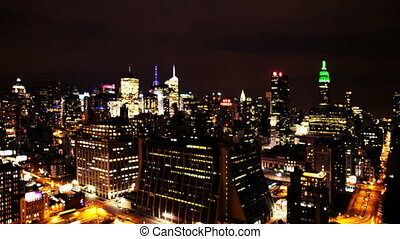 view of manhattan skyline from a high vantage point at night