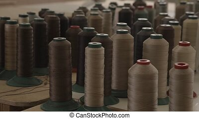 View of many long coils with brown and beige threads - View...