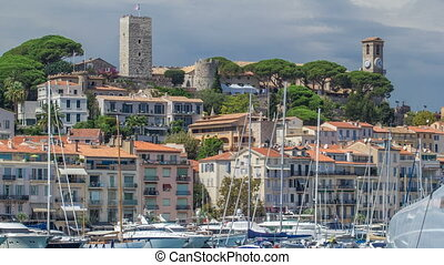 View of medieval Castre Castle and harbor with yachts...