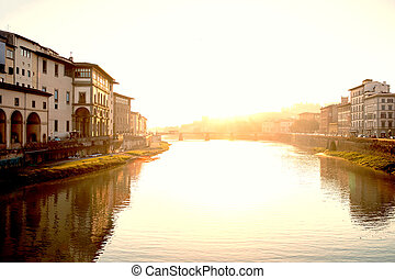 View of medieval stone bridge Ponte Santa Trinita and Arno...