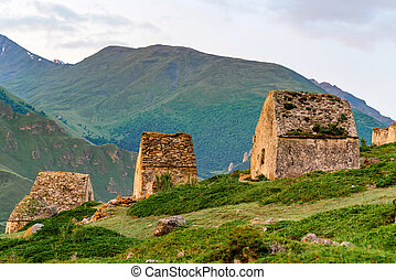 Tombs at medieval cemetery of ancient Alans near the village of Eltyulbyu. Northern Caucasus, Russia. Lightened by setting sun