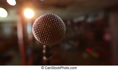 View of microphone on stage facing empty auditorium....