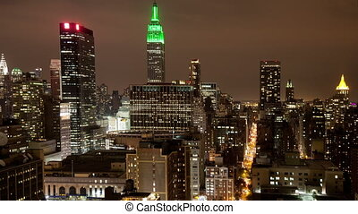 view of midtown manhattan skyline from a high vantage point at night