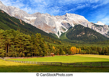 View of Mieminger Plateau with high mountain range in the background, Austrian landscape, Tyrol