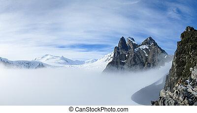 View of misty Orne Harbour glacier from Spigot Peak, Antarctic Peninsula, Antarctica