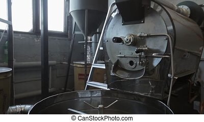 View of mixing machine for fried coffee grains. coffee factory.
