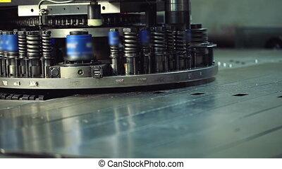 View of modern machine punching metal