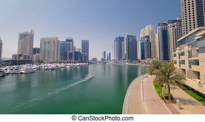 View of modern skyscrapers in Dubai Marina timelapse hyperlapse