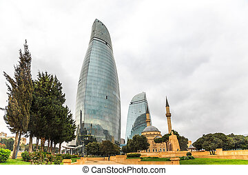 View of mosque and flame towers in Baku, Azerbaijan