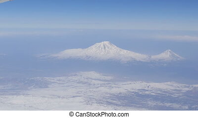 View of Mount Ararat from an airplane. Snow-capped mountain...