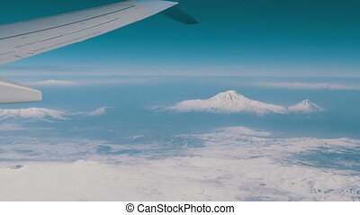 View of Mount Ararat from an airplane. The wing of the plane...