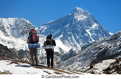 view of Mount Everest, with tourists