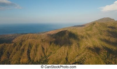 View of mountain and ocean landscape. Bali - Aerial view of...
