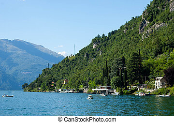 View of mountain lake on a sunny summer day. District of Como Lake, Colico, Italy, Europe