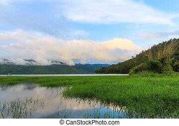 View of mountains on lake.