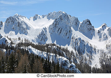 view of moutains with snow in winter from Lussari Mount in...