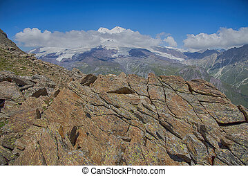 View of Mt Elbrus from Mount Cheget. Caucasus, Russian Federation