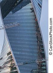 multi-storey building under construction and crane
