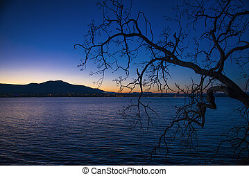 View of Nanaimo bay and skyline at dusk, taken from Jack Point in Nanaimo, British Columbia.