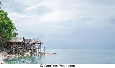 View of nice bungalow on  tropical empty sandy beach