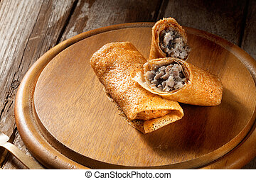 view of nice fresh hot stuffed crepes color background