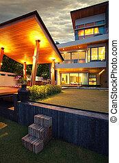 after dark - View of nice modern villa in summer after dark ...